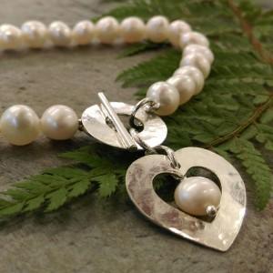 1. White freshwater pearl bracelet with heart.smaller